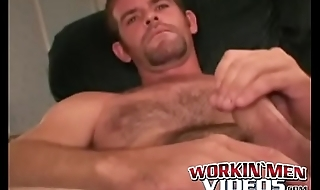 Good looking mature guy takes a piss before wanking his cock