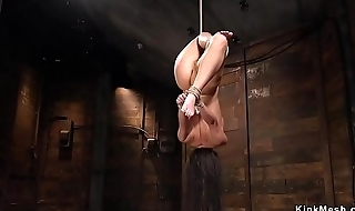 Petite busty babe hogtied and caned