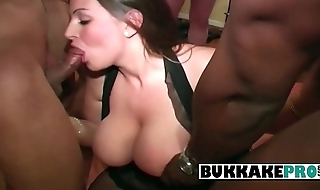 Hot woman is part of interracial bukkake with 7 men while someone takes pictures
