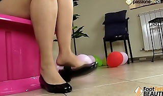 Barefoot brunette shoeplay in ballet flats