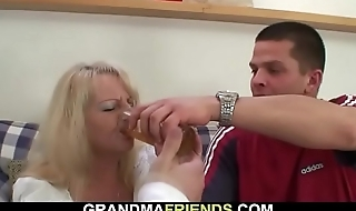 Boozed blonde grandma takes two big cocks from both ends